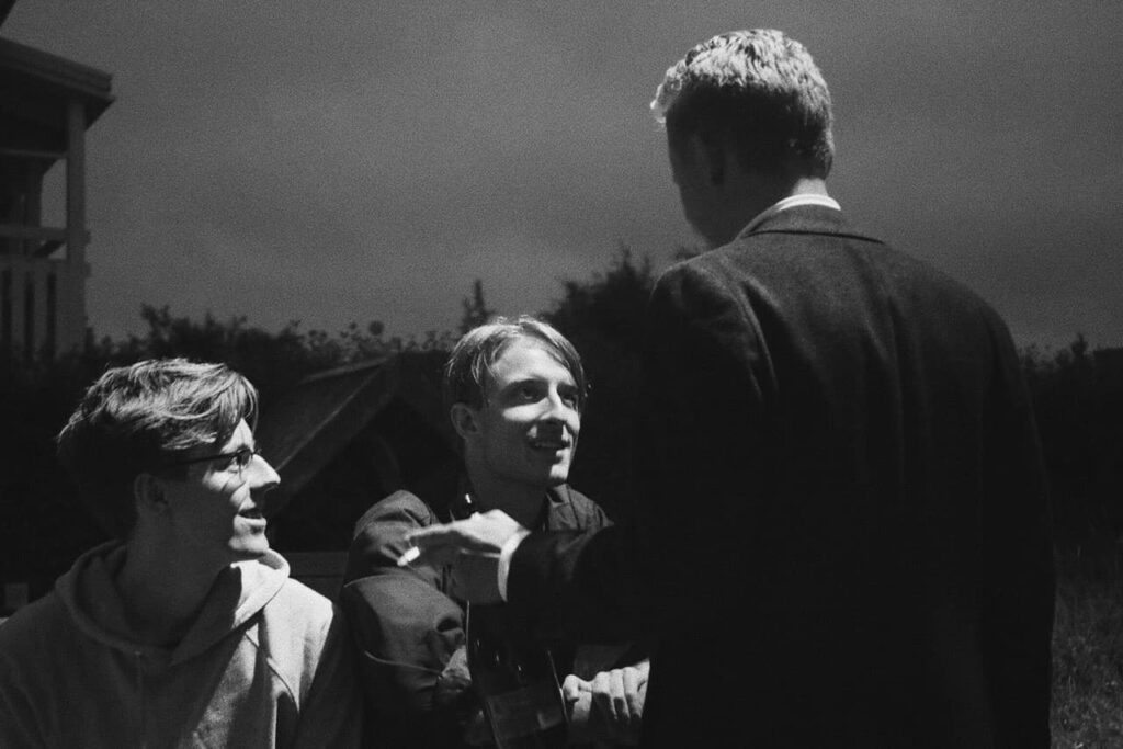 three man smiling, black and white image